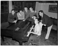 USC Kappa Alpha members sing by a piano inside their fraternity house, Los Angeles, 1940