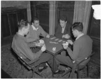 USC Kappa Alpha members play a card game inside their fraternity house, Los Angeles, 1940