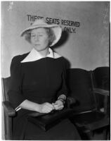 Miss Verona Stinehoff sitting in a chair wearing a white hat, Los Angeles