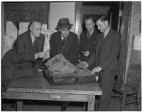 Detective Lieutenants R.S. Hamilton, E.J. Henry, and E.C. Biffle with suspect Adolfo Campos and a suitcase full of smuggled marijuana, Los Angeles