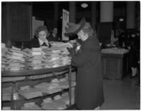 Women shopping for shirts during the semiannual Dollar Day sale in downtown Los Angeles, February 17, 1940