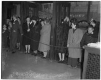 Crowd of shoppers gathered next to a building during the semiannual Dollar Day sale in downtown Los Angeles, February 17, 1940