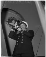 Captain Lars H. Weseth looking through a sextant, Los Angeles, May 23, 1940