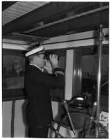 Captain Lars H. Weseth looking through binoculars, Los Angeles, May 23, 1940