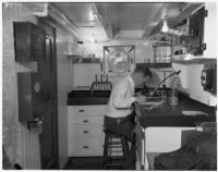 D.H. Fry Jr. in the laboratory of the California Dept. of Fish and Game's research ship, the N.B. Scofield, Los Angeles, May 23, 1940