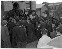 Members of the Worker's Alliance at 1st and Soto Streets protesting a 40% cut to checks given out to S.R.A. relief workers, Los Angeles, February 27, 1940
