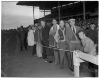 Spectators near the track on a rainy Derby Day at Santa Anita Park, Arcadia, February 22, 1940