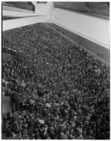 Spectators in the stands on a rainy Derby Day at Santa Anita Park, Arcadia, February 22, 1940