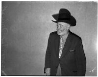 Cowboy film extra Tex Driscoll at hearing of Jerome (Blackjack) Ward, charged with the murder of Johnny Tyke, Los Angeles, February 27, 1940