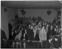 Film extras from Gower Gulch supporting Jerome (Blackjack) Ward at hearing on the murder of Johnny Tyke, Los Angeles, February 27, 1940