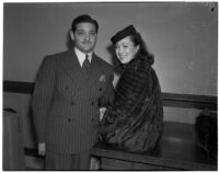 Musician Richard Candreva with his wife Jacqueline in court with a damage suit against actor Victor McLaglen, Los Angeles, March 4, 1940