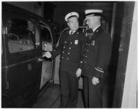 Deputy Fire Chief Herbert A. Krumsiek and Assistant Fire Chief W.H. Augustine, Los Angeles, March 4, 1940