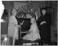 Mrs. A.J. Woodward plays the piano while Mrs. James A. Beck and Mrs. Yvonne Chrarton stand nearby, Los Angeles