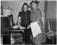 Mrs. Hiram Raney and Mrs. Edna Horton baking biscuits, Los Angeles
