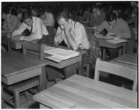 Candidates for police and deputy sheriff positions taking a written examination in City Hall, Los Angeles, March 2, 1940