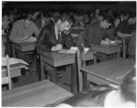 Some of the more than 4000 candidates for police and deputy sheriff positions taking a written examination in City Hall, Los Angeles, March 2, 1940