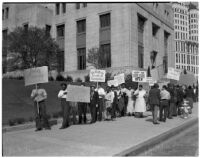 Pickets from the Workers Alliance protesting outside the State Building during S.R.A. hearings, Los Angeles, March 5, 1940