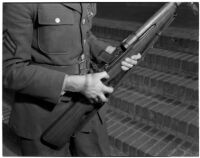 Soldier holding the U.S. Army's new Garand rifle, on display as part of National Defense week, Los Angeles, February 1940