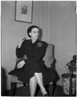 Portrait of dancer and choreographer Martha Graham sitting in a chair, Los Angeles, circa 1940