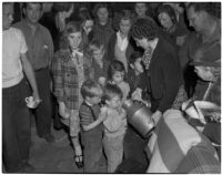 Children getting something to drink in the S.R.A.'s Vermont District office while pickets gathered outside to protest a cut in relief checks, Los Angeles, February 28, 1940