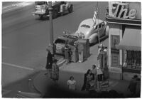 Aerial view of pedestrians and Owl Drug on the corner of Hollywood and Vine, Los Angeles, 1940