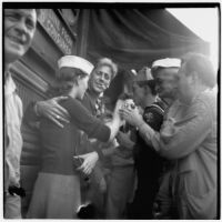 Group celebrates Japan's surrender during World War II on Main Street in downtown Los Angeles, August 15 and 16, 1945