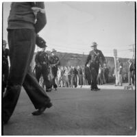 Police and strikers in the background during the Conference of Studio Unions strike against all Hollywood studios, Los Angeles, October 19, 1945