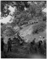 Fire fighting crew in La Canada surveying damage from a brush fire, Los Angeles, October 1945