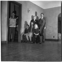 Louis M. Rich and family sit in their empty home after being evicted on Thanksgiving Day, Los Angeles, November 22, 1945