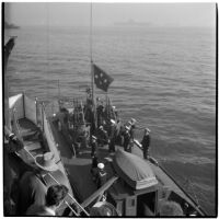Naval officers perform a changing of the flags ceremony aboard the U.S.S. South Dakota to signal the retirement of Admiral William F. Halsey, Los Angeles, 1945