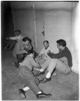 Studio employees playing cards during the Conference of Studio Unions strike against all Hollywood studios, Los Angeles, 1945