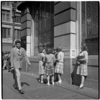 Woman talking to a group of truant girls in downtown Los Angeles, March 1946