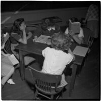 Five girls sitting around a table in a classroom, Los Angeles, March 1946