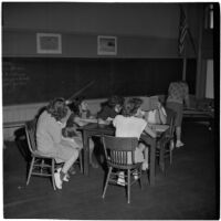 Six girls sitting around a table in a classroom, Los Angeles, March 1946