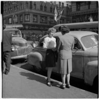 Woman talking to a truant girl in downtown Los Angeles, March 1946