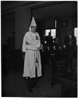 Former Ku Klux Klan Kleagle, Ray J. Schneider, in Klan robes at trial, Los Angeles, 1946