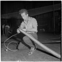 Wirewalker Hubert Castle prepares for his act at the Shrine Charity Circus, Los Angeles, June 1946