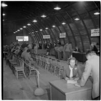 Veterans fill out paperwork to purchase surplus trucks and trailers from the War Assets Administration, Port Hueneme, May 1946