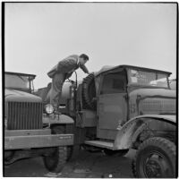 Man checks out a truck at the War Assets Administration's surplus sale, Port Hueneme, May 1946