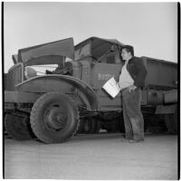 Manuel Sanchez at the War Assets Administration's surplus truck and trailer sale, Port Hueneme, May 1946