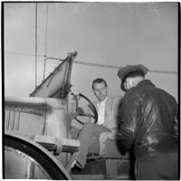 George Roberts purchases the first truck sold at the War Assets Administration's surplus truck and trailer sale, Port Hueneme, May 1946