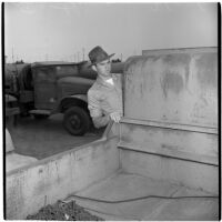 Eldon Farthing examines a truck during the War Assets Administration's surplus sale, Port Hueneme, May 1946