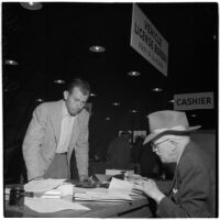 George Roberts fills out paperwork to purchase the first truck sold at the War Assets Administration's surplus sale, Port Hueneme, May 1946