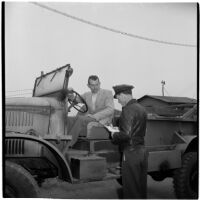 George Roberts purchases the first truck sold at the War Assets Administration's surplus sale, Port Hueneme, May 1946