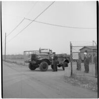 George Roberts drives away after purchasing the first truck at the War Assets Administration's surplus sale, Port Hueneme, May 1946