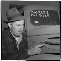 F.W. Fetherston examines a truck that is for sale at the War Assets Administration's surplus sale, Port Hueneme, May 1946
