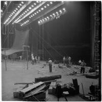 Members of the Polack Bros. Circus set up for their show inside Shrine Auditorium, Los Angeles, June 1946
