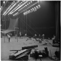 Members of the Polack Bros. Circus set up for their show inside Shrine Auditorium, Los Angeles, June 1946