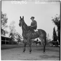 Jockey sits atop race horse Sea Image outside the Santa Anita Park stables, Arcadia, March 9, 1946
