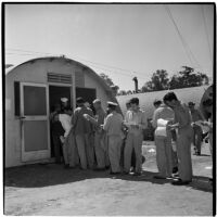Veterans lined up to purchase Quonset huts and other surplus military supplies, Port Hueneme, July 15, 1946